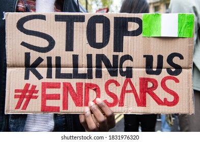 London, UK. 11th Oct. 2020. Protesters are calling for the scrapping of police unit, known as Special Anti-Robbery Squad (SARS) over the squads incessant harassment and brutality of innocent Nigerians