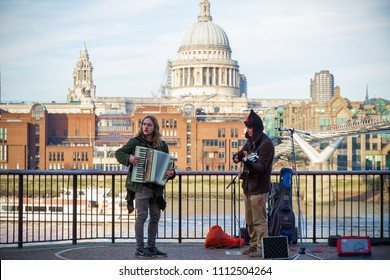 London, UK - 12 April, 2018 - Street musicians on the South Bank with St Paul's Cathedral in the background