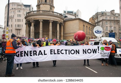 London, UK. 12th January 2019. Anti-Tory party protesters with posters, campaigning against austerity at the Britain is Broken- General Election Now national demonstration in Central London, UK.