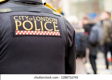 London, UK. 12th January 2019. City of London Police sign on the back of a body armour vest jacket worn by police officers escorting & monitoring a street demonstration through central London, UK.
