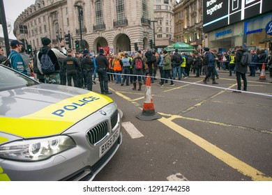 London, UK. 12th January 2019. Police patrol car creates a roadblock in Piccadilly Circus, London, to stop all traffic ahead of a nearby street demonstration, to ensure public safety at all times.