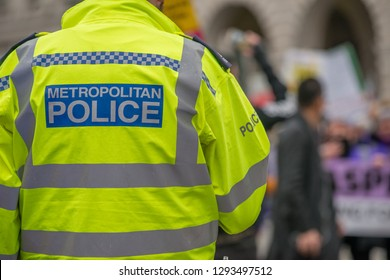 London, UK. 12th January 2019. Metropolitan Police sign on the back of a high visibility jacket worn by police officers escorting & monitoring a street demonstration through central London, UK.