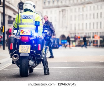 London, UK. 12th January 2019. Police motorcycle riders, escort and clear the roads ahead of any traffic for a planned street demonstration which is following close behind, through central London, UK.