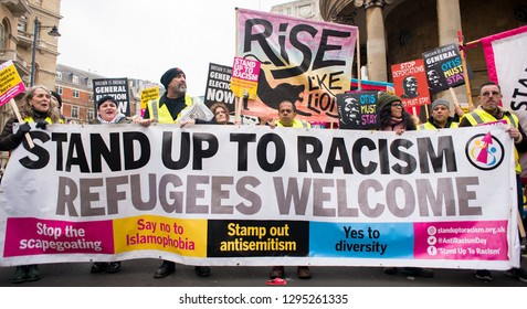 London, UK. 12th January 2019. Anti-Racism protesters with large banner, campaigning against austerity at the Britain is Broken- General Election Now national demonstration in Central London, UK.