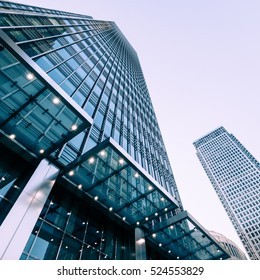 London, UK - 13 May 2015: A low and wide angle view of converging skyscrapers in the business and financial district of London Docklands.