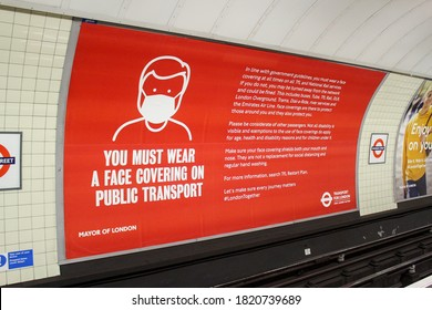 London / UK - 13 September 2020: 'You must wear a face covering on public transport' coronavirus London Underground station sign