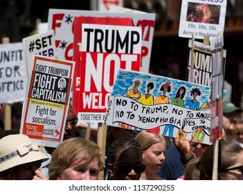 London, UK. 13th July 2018. EDITORIAL - Protestes holding anti Trump placards at the #BringTheNoise Women's March Anti Donald Trump protest demonstration through the streets of central London, UK.