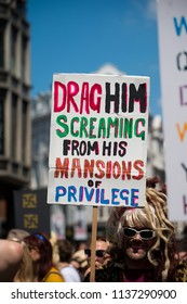 London, UK. 13th July 2018. EDITORIAL - Protester holding homemade poster at the #BringTheNoise Women's March Anti Donald Trump protest demonstration through the streets of central London, UK.