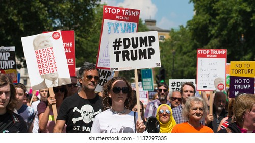 London, UK. 13th July 2018. EDITORIAL - Protesters holding and waving placards at the #BringTheNoise Women's March Anti Donald Trump protest demonstration through the streets of central London, UK.