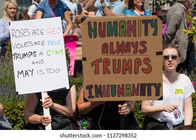 London, UK. 13th July 2018. EDITORIAL - Protesters holding homemade posters at the #BringTheNoise Women's March Anti Donald Trump protest demonstration through the streets of central London, UK.