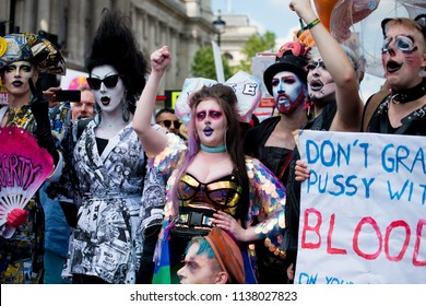 London, UK. 13th July 2018. EDITORIAL - Gay and LGBT protesters in costume at the #BringTheNoise Women's March Anti Donald Trump protest demonstration through the streets of central London, UK.
