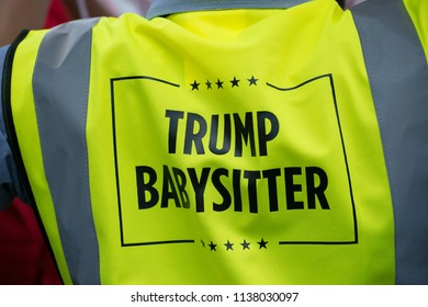 London, UK. 13th July 2018. EDITORIAL - One of the Baby Trump blimp babysitters at the #BringTheNoise Women's March Anti Donald Trump protest demonstration through the streets of central London, UK.