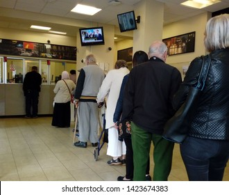 LONDON/ UK- 13th June 2019: Senior citizens queue up in bank on pension day. Many bank counters are being closed in the UK and replaced with automated machines.