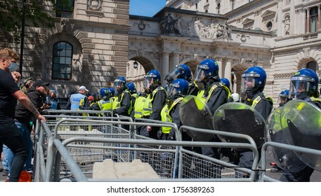 London, UK. 13th June 2020. Riot police in Whitehall behind barriers, preventing far right supporters clashing with anti-racism protesters during a period of high profile statues being vandalised.