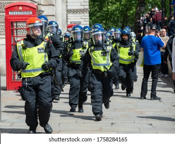 London, UK. 13th June 2020. Riot police running through Whitehall, to prevent far right supporters clashing with anti-racism protesters during a period of high profile statues being vandalised.