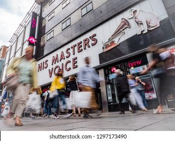 LONDON, UK - 14 AUGUST 2018: HMV, Oxford Street. The shop front to the flagship HMV media retailer on Oxford Street, London.  Long exposure creating an anonymous blur of passing shoppers.