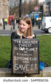 London, UK. 14th February 2020. Student activist with placard at the Youth Strike 4 Climate demonstration rally at Parliament Square, in protest of the government's lack of action on climate change.