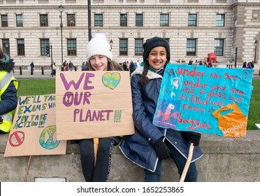 London, UK. 14th February 2020. Student activists with placards at the Youth Strike 4 Climate demonstration rally at Parliament Square, in protest of the government's lack of action on climate change.