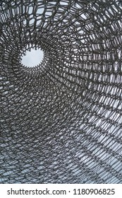 London, UK - 14th June 2018: looking up inside 'The Hive' an art installation by Wolfgang Buttress, 17 metres tall and constructed out of 170,000 aluminium parts