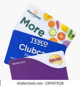London, UK - 14th May 2019 - Sainsburys Nectar card, Tesco clubcard and Morrisons More cards isolated on a white background