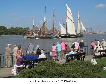 LONDON/ UK- 14th September 2014: People watching sailing ships, on the river thames at Greenwich, London.