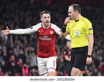 LONDON, UK - 15 MARCH 2018: Aaron Ramsey and referee Jonas Eriksson pictured during the UEFA Europa League Round of 16 game between Arsenal FC and AC Milan at Emirates Stadium.