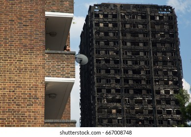 London UK. 15th June 2017  A hose continues to douse the fire at Grenfell Tower . At least 17 people have been confirmed dead and dozens missing.