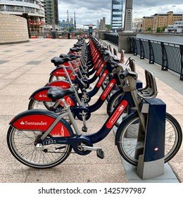 London, UK - 15th June 2019: Pay as you go hire / rental bicycles docked in Canary Wharf.