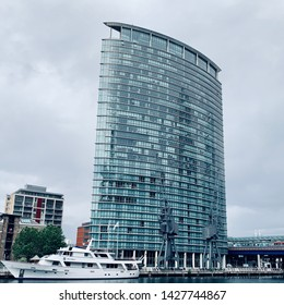 London, UK - 15th June 2019: The Absolute Pleasure yacht hotel moored in West India dock in front of the Marriot Hotel, Canary Wharf.