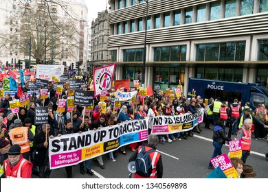 "London, UK. 16th Feb, 2019. Protestors hold banner ""Stand Up To Racism"" and ""No To Islamophobia"" during Anti Racism Demonstration in London."