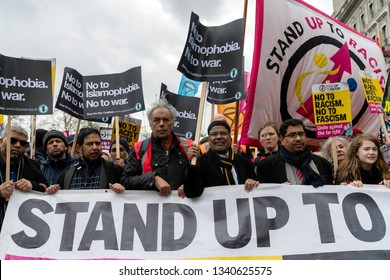 """London, UK. 16th Feb, 2019. People come together to protest against far-right groups in UK and Europe. Muslim community with banners """"No To Islamophobia No To War""""."""