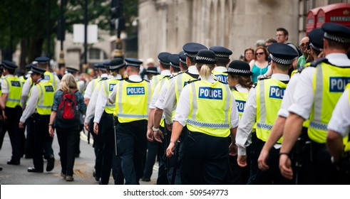 London, UK. 16th July 2016. EDITORIAL - Police escort for the Black Lives Matter protest rally - Thousands attended the march through London, in protest of recent killings of black men by U.S. police.
