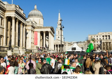 LONDON, UK - 16TH MARCH 2014: St Patrick's day celebrations at Trafalgar Square in central London showing large crowds of people
