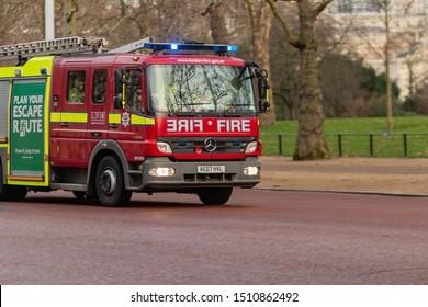 London, UK - 17, December 2018: Emergency response - fire truck rushes down street at London UK.