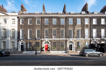 LONDON, UK - 17 MAY 2018: Georgian town houses, Bedford Square, London. A row of London town houses in Bedford Square, Bloomsbury, providing a classic example of Georgian architecture.