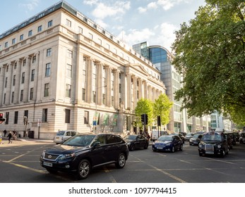 LONDON, UK - 17 MAY 2018: The Wellcome Trust. A view of the headquarters to the biomedical research organisation The Wellcome Trust on Euston Road in central London with foreground traffic.