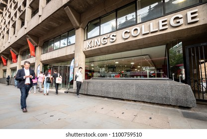 LONDON, UK - 17 MAY 2018: Students and pedestrians passing the entrance to the Strand Campus building of King's College, London.