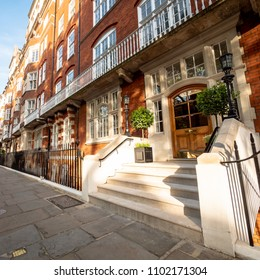 LONDON, UK - 17 MAY 2018: A low angle view of the entrance to a typical London Edwardian mansion block of flats from the early 20th Century in the heart of Bloomsbury, North London.