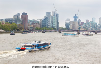 London, UK - 17 May 2019 - Thames river clipper boat and Lambeth Bridge. Lambeth Bridge is a road traffic and footbridge crossing the River Thames iin central London