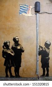"""LONDON, UK - 17TH JUNE 2008: Bansky's """"Allegiance to Tesco"""" Graffiti in London."""
