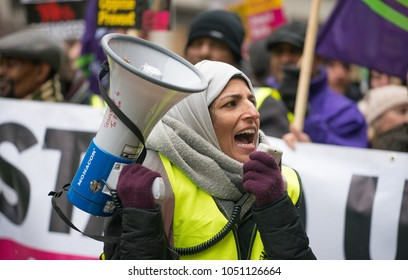 London, UK. 17th March 2018. EDITORIAL - Muslim woman activist using megaphone at the March Against Racism national demonstration, London, in protest of the dramatic rise in race related attacks.