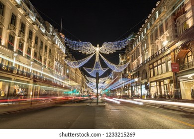 LONDON, UK - 17TH NOVEMBER 2018: Views along Regent Street at night showing Christmas decorations along the street.