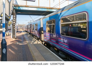 London, UK. 17th November 2018.  Alexandra Palace station on the East Coast Mainline just outside London. A Class 313 Great Northern Service is about to depart.