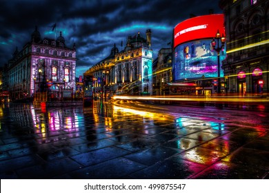 LONDON, UK - 17TH OCTOBER 2016: Part of Piccadilly Circus HDR styled image of Piccadilly Circus in London by night, with rain and light trails.