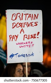 London, UK. 17th October 2017. EDITORIAL - Protester holding a placard at the Britain Deserves A Pay Rise protest rally and demonstration, in Parliament Square, London, UK.