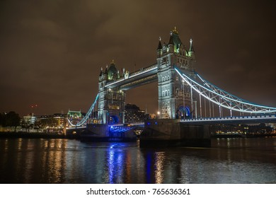London / UK - 18 November 2017: Tower Bridge at night with lighting in cloudy sky