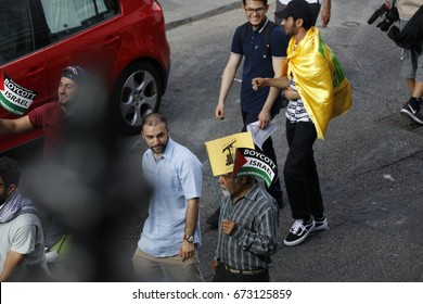 London, UK - 18th June 2017.  Al Quds Day march through London with participants waving flags including the flag of Hezbollah