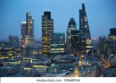 London, UK - 19 December, 2016: London at night, view from st. Paul's cathedral. Modern skyscrapers of financial aria.
