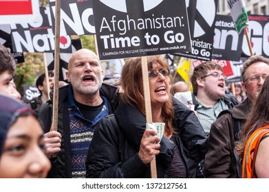 """LONDON, UK - 19 May 2012: people hold placards reading 'Afghanistan: Time to Go"""" during an anti-war pacifist rally outside the US Embassy in London"""