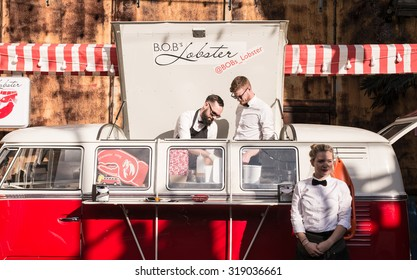 London, UK - 19 September 2015: Pop-up food stall in a vintage van with hipster chefs selling lobster and burger in the trendy London area of Shoreditch.